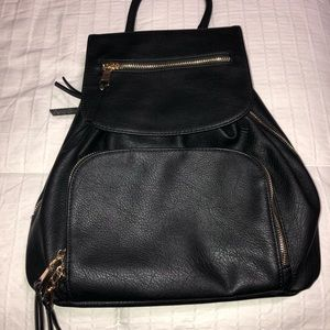 Faux leather back pack with gold hardware